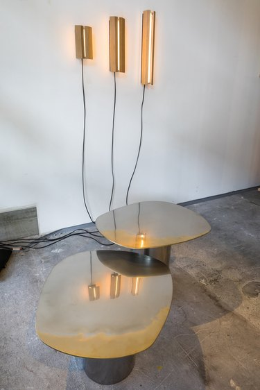 polished brass stainless-steel tables by corinna warm