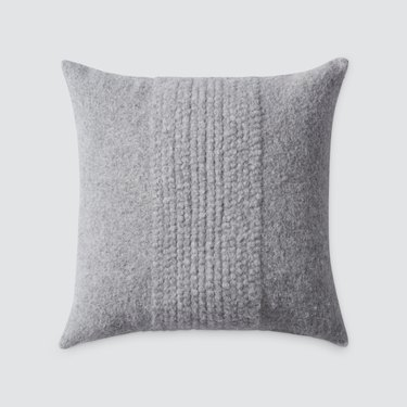 gray handwoven textured pillow