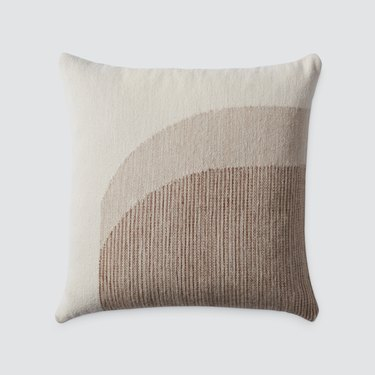 curved neutral tones pillow