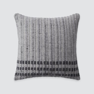 gray textured pillow with stripes