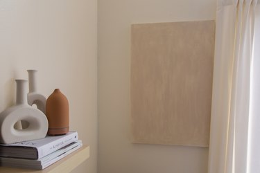 Beige painted wall and painting