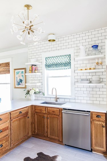 Countertops with Oak Cabinets in traditional oak kitchen with white laminate countertop