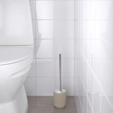 toilet brush near toilet