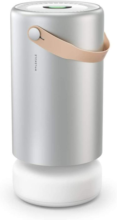 silver air purifier with tan handle