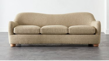 curved sofa in beige color