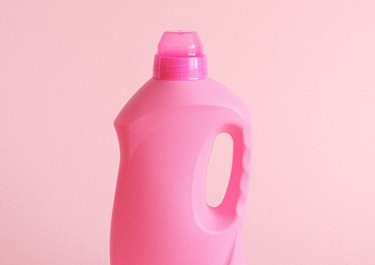 pink laundry detergent bottle with pink clear plastic cap