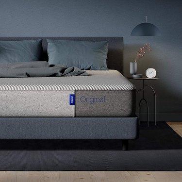 gray casper mattress on navy bedframe