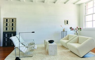 room with seating and art with white walls