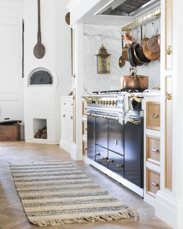 jute kitchen rug in front of stove in rustic country kitchen