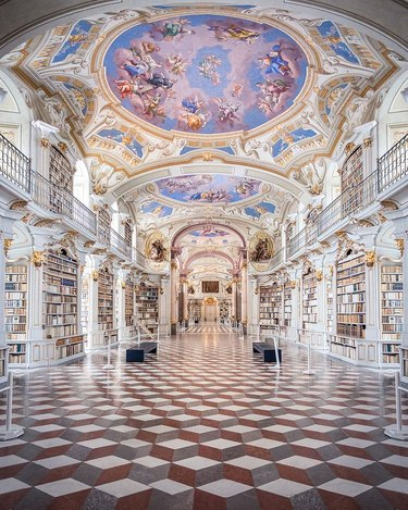 interior picture of the admont abbey library with art on ceilings