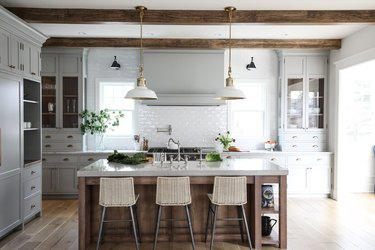 white and brass barn lights hanging in farmhouse kitchen