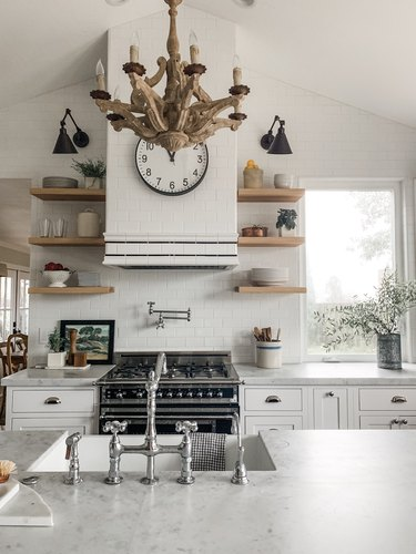 white farmhouse kitchen with wood chandelier above island