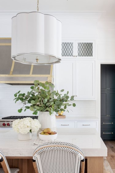 large pendant light with sizeable shade above island