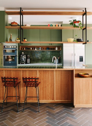 Should Wall Color Match Kitchen Cabinets midcentury kitchen with wooden and green cabinets