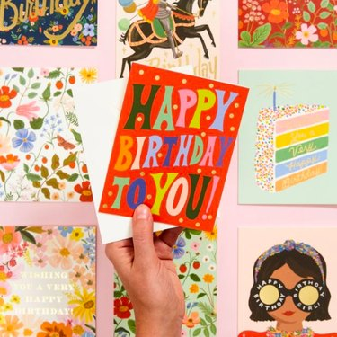 hand holding red birthday card