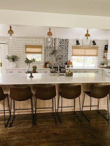 clear glass lights above island in modern farmhouse kitchen