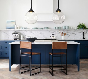 counter stools by blue kitchen island