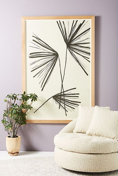 round accent chair with large wall art