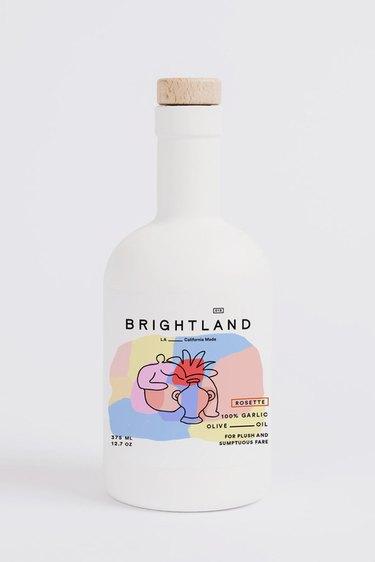 white olive oil bottle with pastel logo