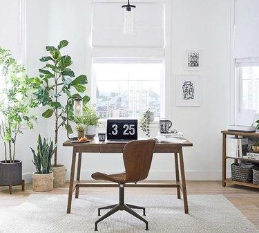 gray jute rug under wood desk in white office