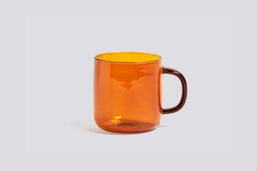 orange borosilicate mug with dark handle