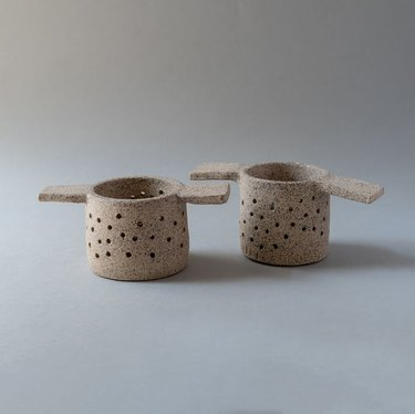 West Elm Utility Objects Tea Strainer over gray background