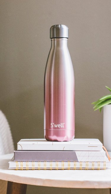 S'well 17 oz. Dawn Bottle on books and notebooks