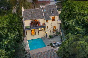 overview photo of storybook home with pool