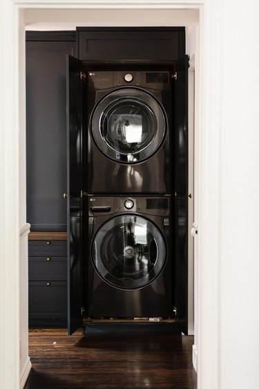 black washer and dryer stacked
