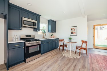 blue cabinets in small kitchen