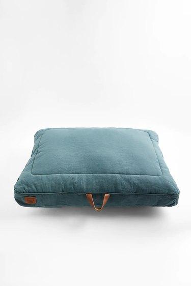 large dog bed in teal color