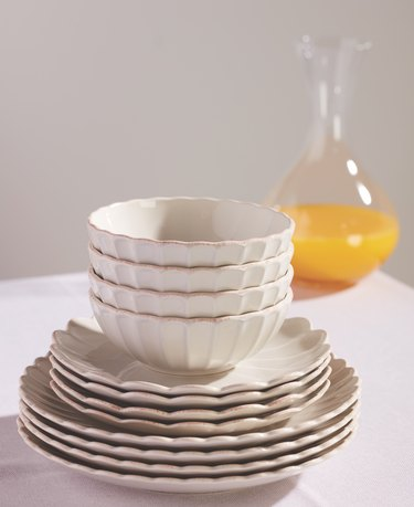plates and bowls stacked on table