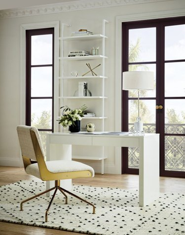 white home office with modern white furniture