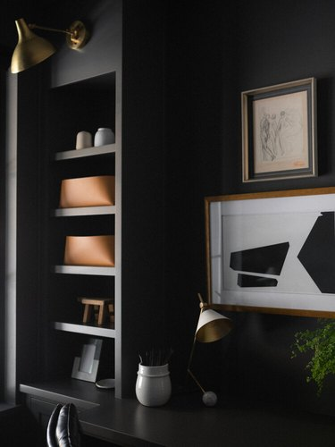 brass traditional wall sconce in modern black office