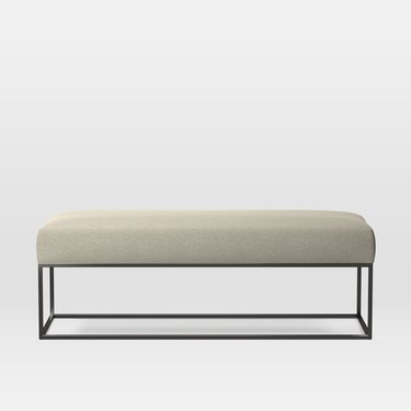 upholstered bench with beige cushion