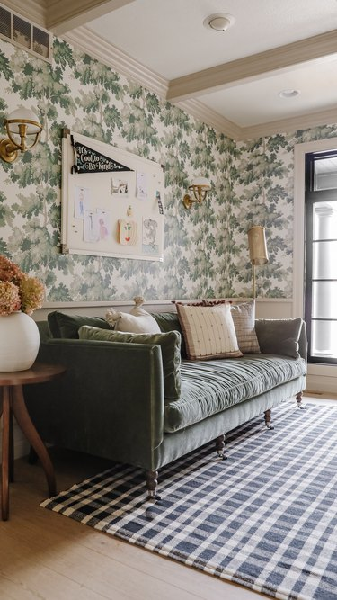 modern brass floor lamp in vintage-inspired office with green wallpaper