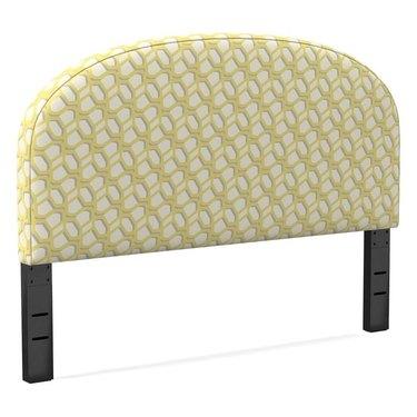 curved headboard in yellow pattern
