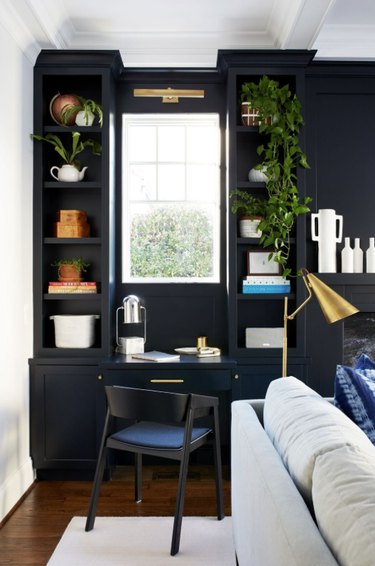 black and white home office with desk and built in shelves