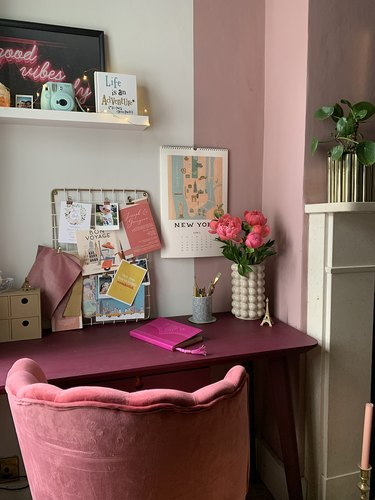 pink and white home office with magenta desk and velvet pink desk chair