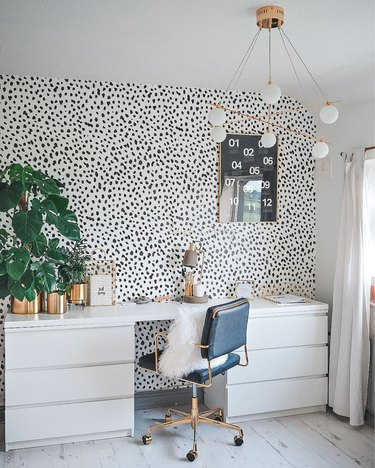 black and white home office with glam furniture and chandelier