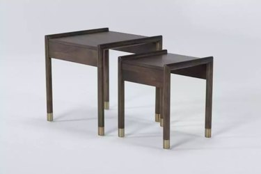 two nesting tables in dark wood