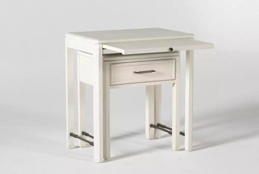 two white nesting tables