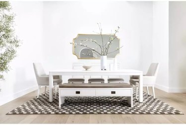 dining room with white bench, table, and chairs