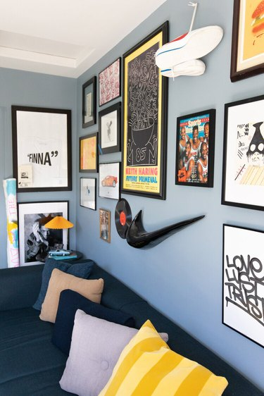 Duett Interiors founder Tiffany Thompson office with blue walls and art gallery wall