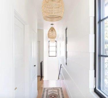 Hallway Pendant Light in Hallway with wicker pendant lights, runner.