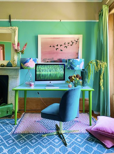 technicolor maximalist home office with turquoise walls, teal desk and blue office chair
