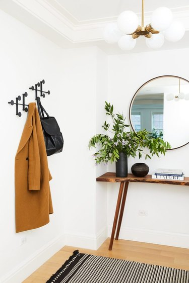 scandinavian hallway with small table and coat rack
