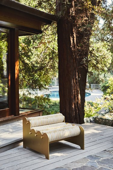 photo of outdoor furniture placed among trees by LAUN