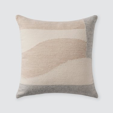 marbled pillow with neutral tones