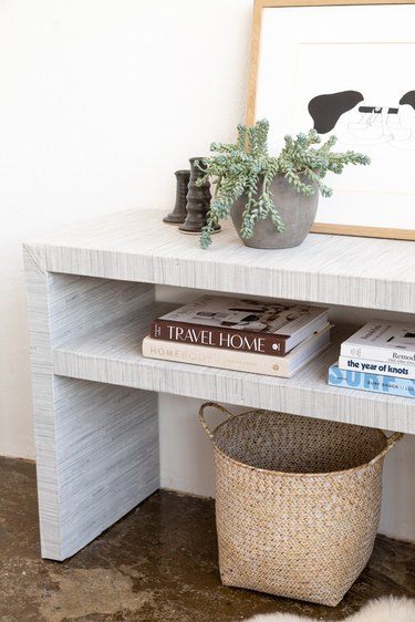 Ikea Hack grasscloth console table styled with books, plants, basket